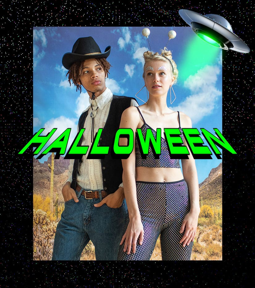 a guy and a girl dressed up as a cowboy and an alien for halloween