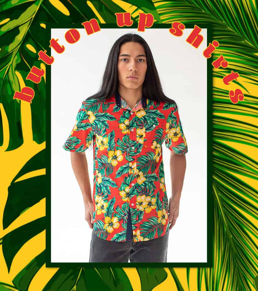 male model wearing a hibiscus button up shirt