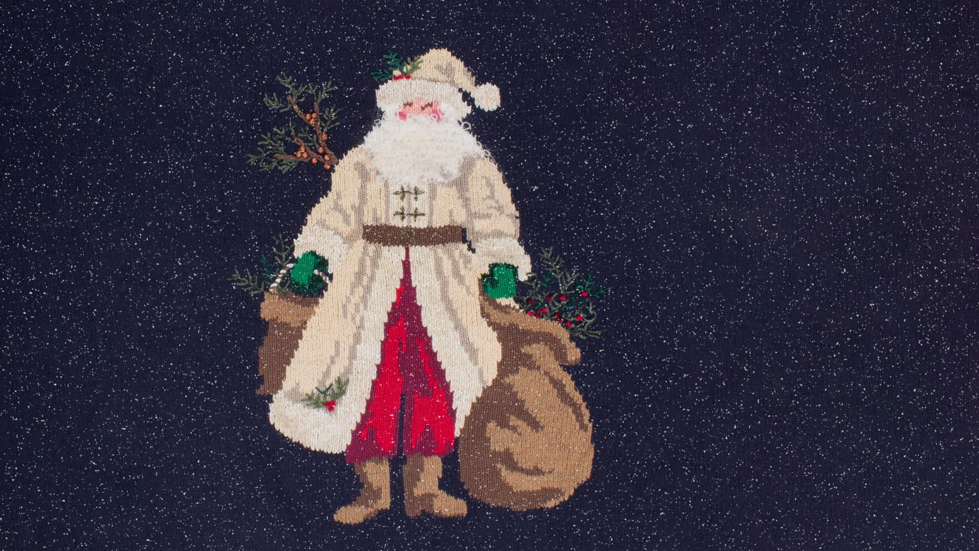 Ugly Christmas sweater featuring a Santa Claus figure carrying bags of wood with a snowy background