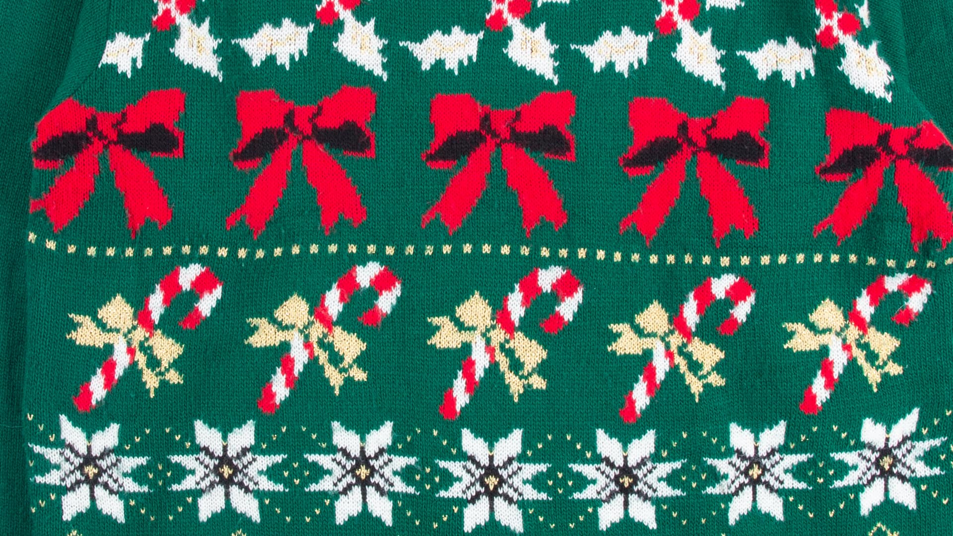 Ugly Christmas sweater featuring rows of bows and candy canes on a dark green background.
