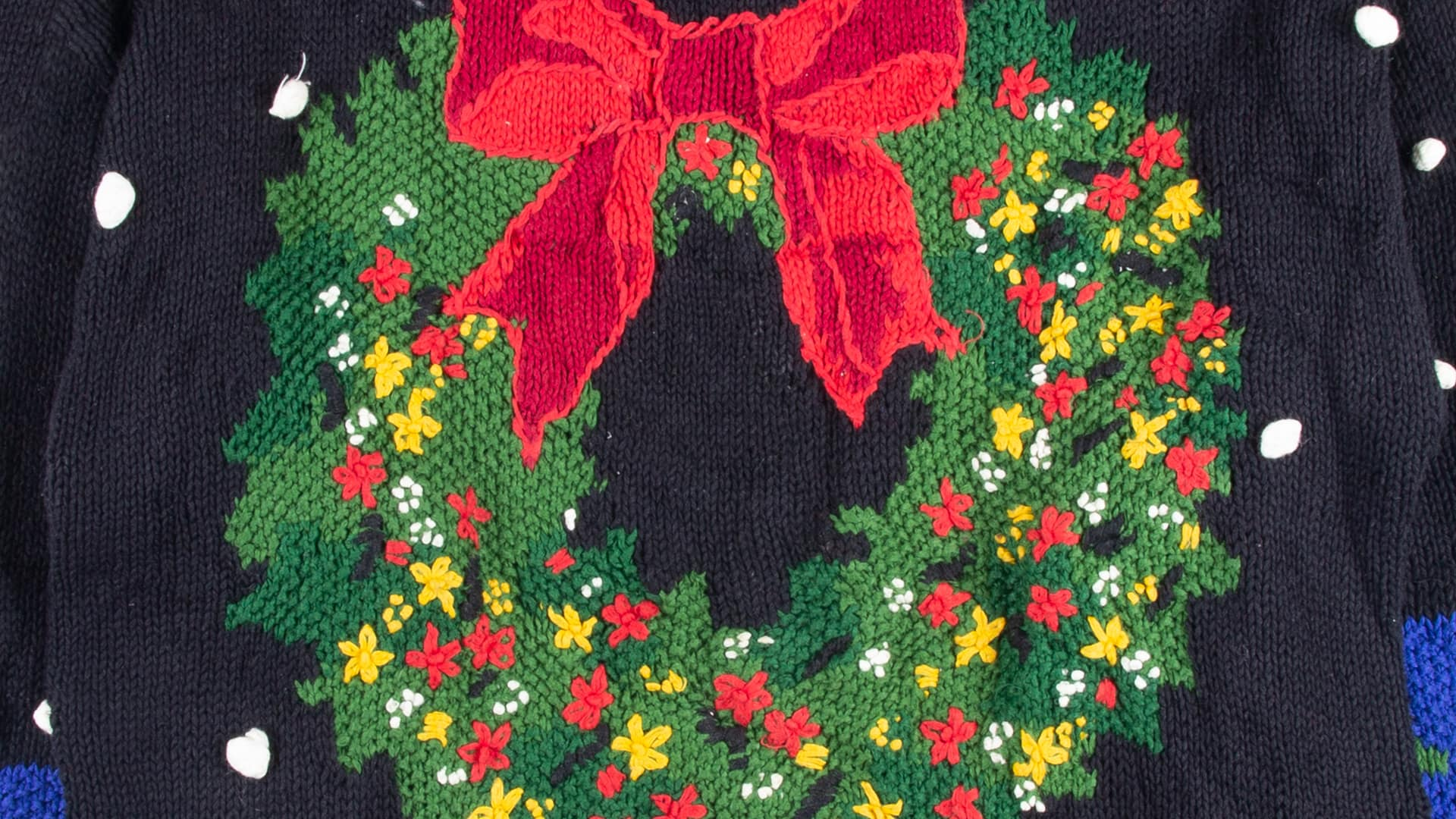 Ugly Christmas sweater featuring a wreath with a large red bow