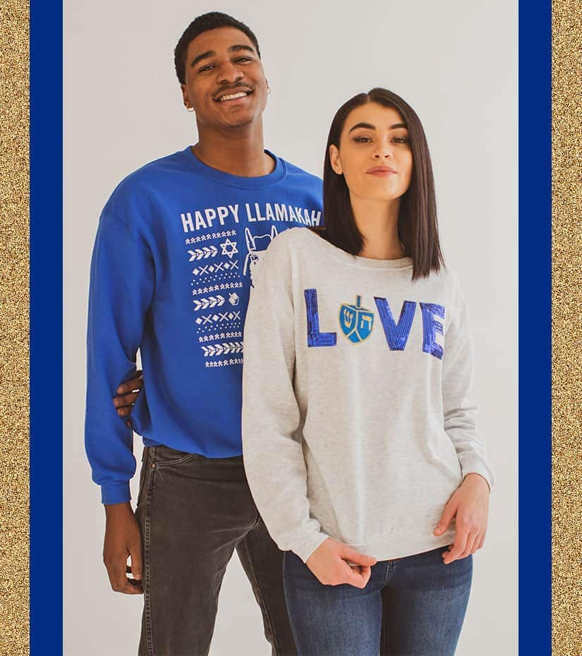 guy and girl wearing Hanukkah sweaters