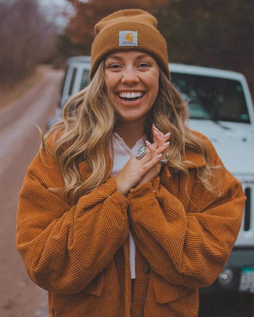 woman wearing a beanie and smiling