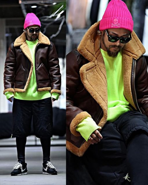 person wearing a bright pink beanie and neon sweatshirt