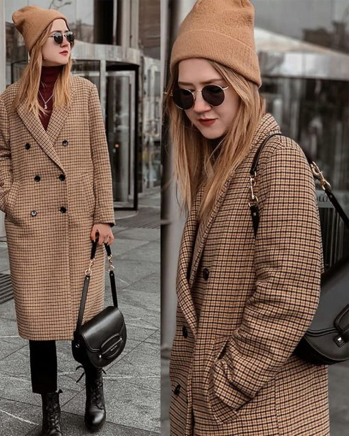 person wearing a beige beanie and long checkered coat