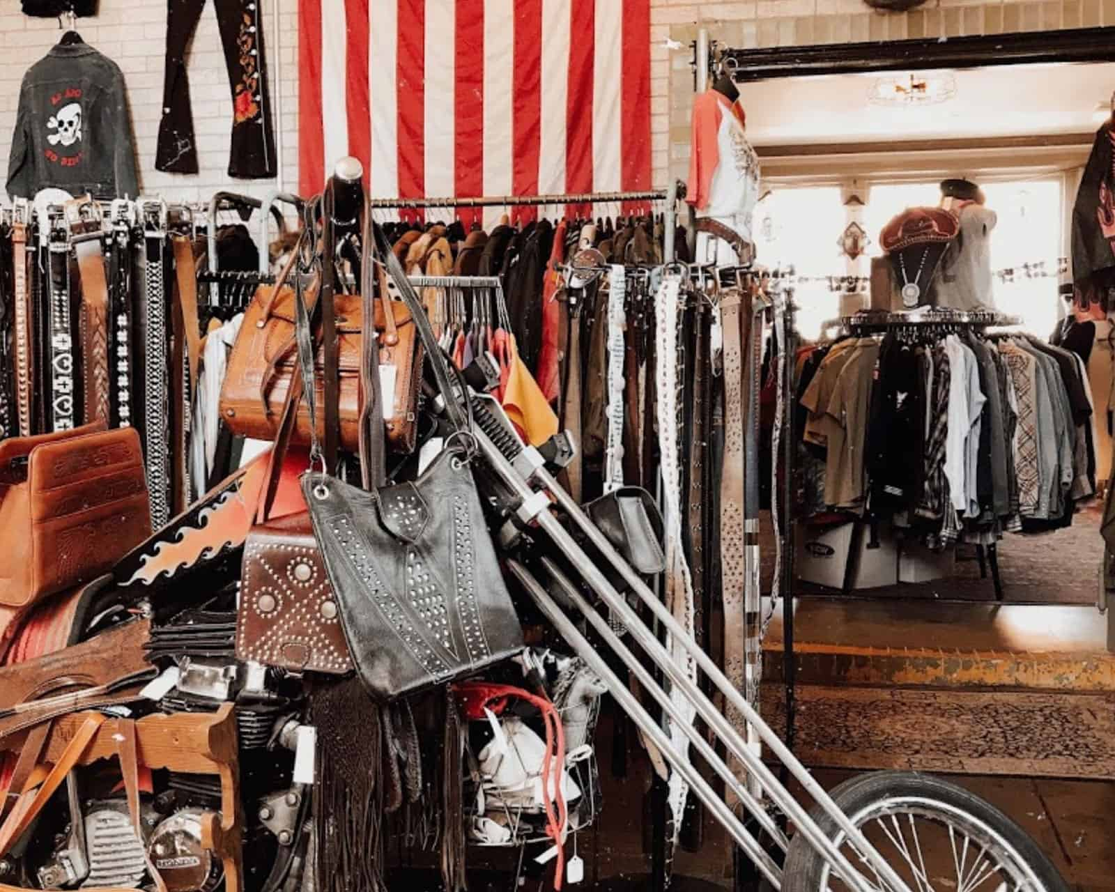 A motorcycle and belts inside Blag Shag vintage store in Nashville