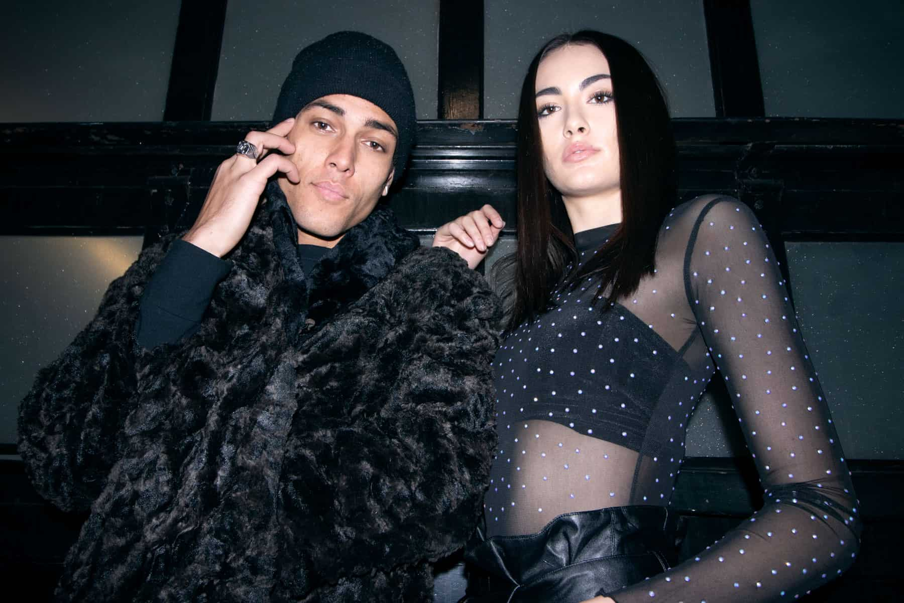 Man and woman wearing faux fur coat and rhinestones