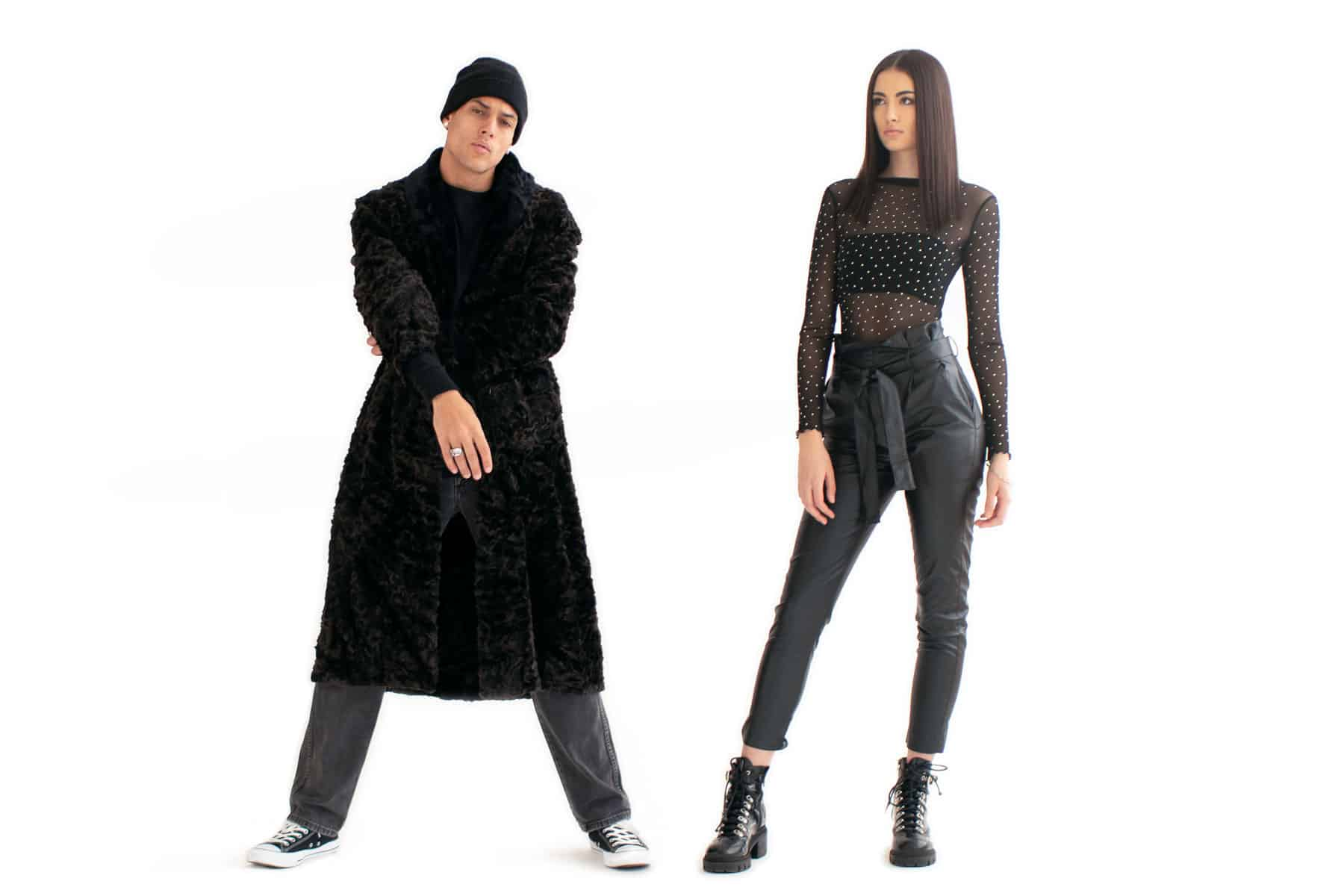 Man and woman standing apart from each other wearing all black