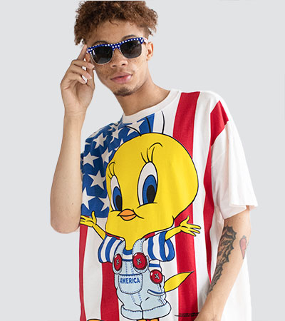 man wearing sunglasses and recycled t-shirt featuring tweety bird
