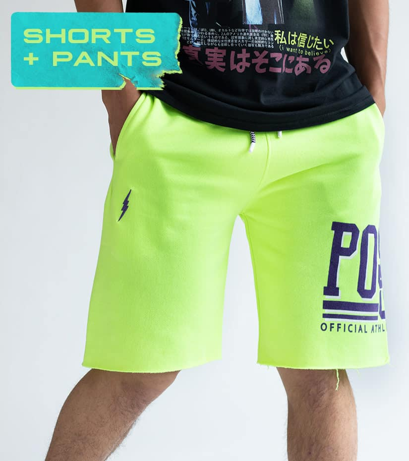 close up of neon green cut off shorts