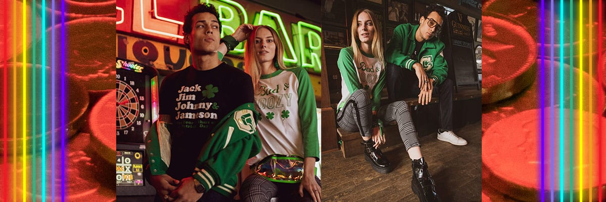 models wearing st patrick's day apparel in a bar