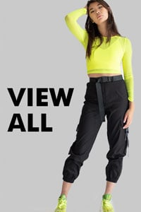 standing woman wearing neon shirt and pants