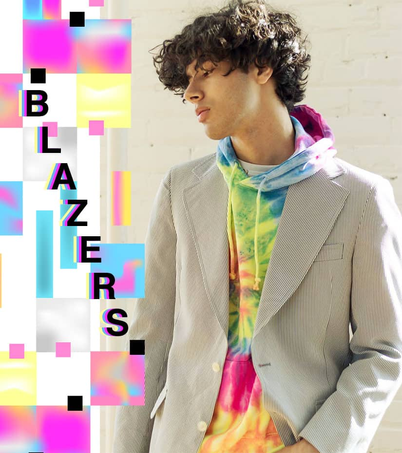 male model wearing vintage blazer and a tie dye hoodie