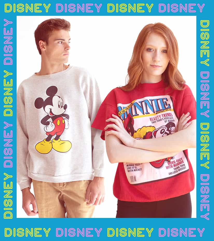 guy and girl wearing vintage disney sweatshirts