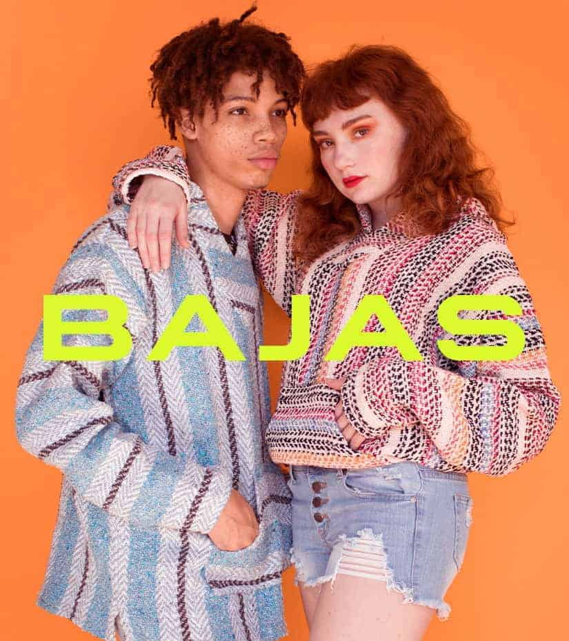 couple wearing drug rug baja hoodies