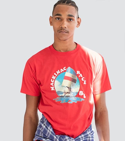 man wearing vintage t-shirt with sailboat